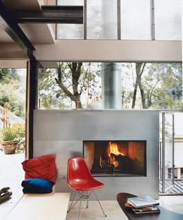How This Couple Broke The Rules in a LA Suburb - Photo 4 of 9 - Galvanized steel was used to clad the fireplace.
