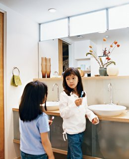"How This Couple Broke The Rules in a LA Suburb - Photo 7 of 9 - Kai and Téa brush their teeth in the upstairs bathroom shared by all. ""We went with the 1950s thing—a family bathroom,"" explains Blatt. The sinks are by Kohler."
