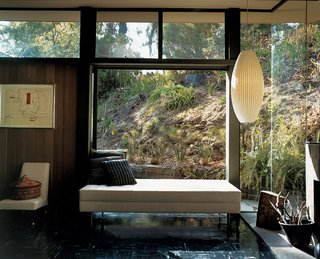 Mutual Fulfilment - Photo 3 of 7 - Near floor-to-ceiling window walls frame views of the landscaped hillside.