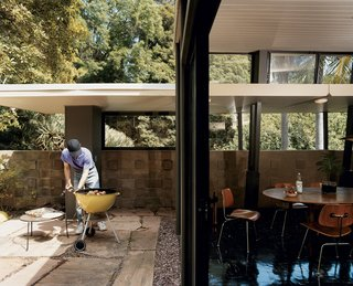 Mutual Fulfilment - Photo 2 of 7 - In his writing geared toward builders, A. Quincy Jones encouraged using large panes of glass and sliding doors to bridge the exterior and interior. Here, Nick Roberts puts the philosophy to good use for a weekend barbecue.