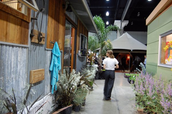 At left, an outdoor shower is installed outside Reclaimed Space's 400-square-foot structure. Modern Shed is at right.