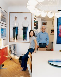 Didier Krzentowski and his wife, Clémence, in the dining room of their Paris flat. The Slim table was designed by Martin Szekely for a Galerie Kreo exhibition in 1999. On the wall, above a Marc Newson Alufelt chair, is a photograph of Krzentowski by Erwin Wurm.