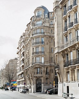 Bordering the Seine, the turn-of-the-century building housing the Krzentowski apartment belies little of what lies within. Photo by Philippe Munda.