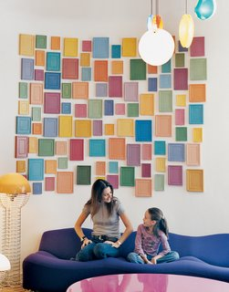 How to Design with Pink - Photo 6 of 15 - Clémence and daughter Clara, nine, relax on a purple Pierre Paulin 261 sofa below an installation by artist Alan McCollum. A small family of Verner Panton 1969 Wire lamps, featured in the inaugural Kreo exhibition, live to the left.