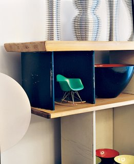 Like a Kid in a Candy Store - Photo 2 of 14 - A miniature Eames rocker nestles in a Charlotte Perriand bookcase.