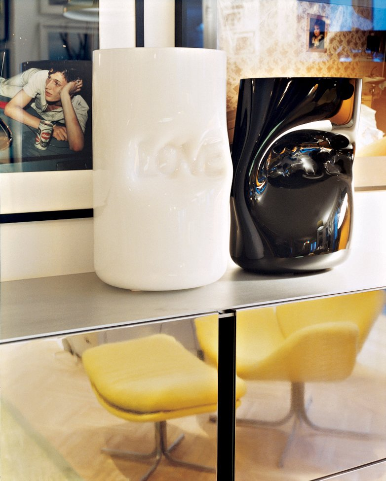 Murano glass vases by Jerszy Seymour rest atop a Maarten van Severen shelving unit in the sitting room.
