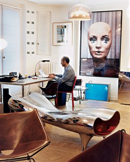Like a Kid in a Candy Store - Photo 8 of 14 - Krzentowski, who works from home for three hours a day, at his desk. A Marc Newson Orgone stretch lounge occupies the foreground, while a large Paul McCarthy photograph looms behind.