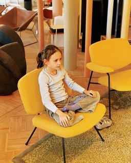 Like a Kid in a Candy Store - Photo 9 of 14 - Clara strikes a yoga pose on a vintage Pierre Paulin chair for Artefort.