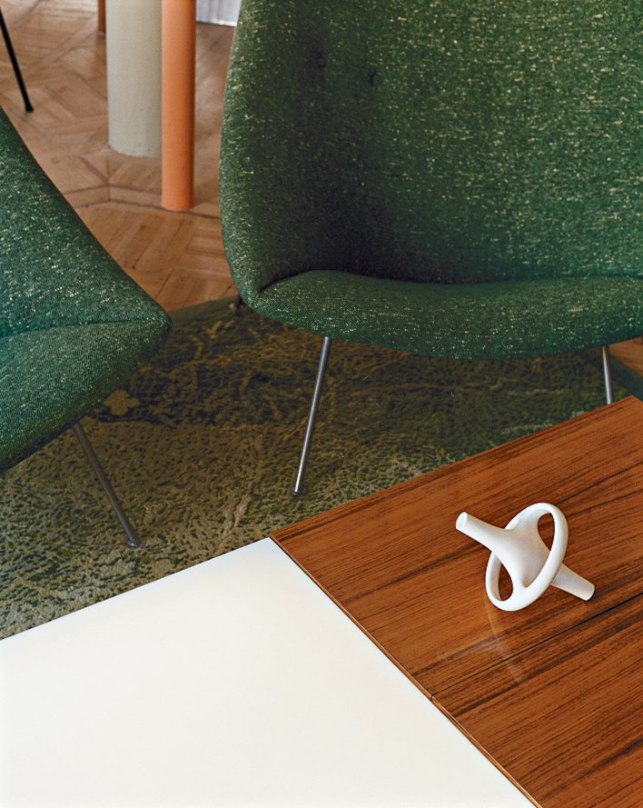 A ceramic Bouroullec vase sits atop a coffee table by Joseph-André Motte.  Photo 13 of 14 in Like a Kid in a Candy Store
