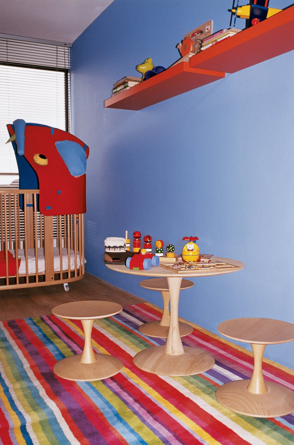 Evidence of the children's burgeoning furniture collection is found in their room, which features an Eames Hang-It-All (not shown) and a bed/crib by Stokke. Tagged: Kids Room and Bedroom.  Photo 13 of 20 in 20 Cool Cribs for the Modern Baby from Furniture Fascination