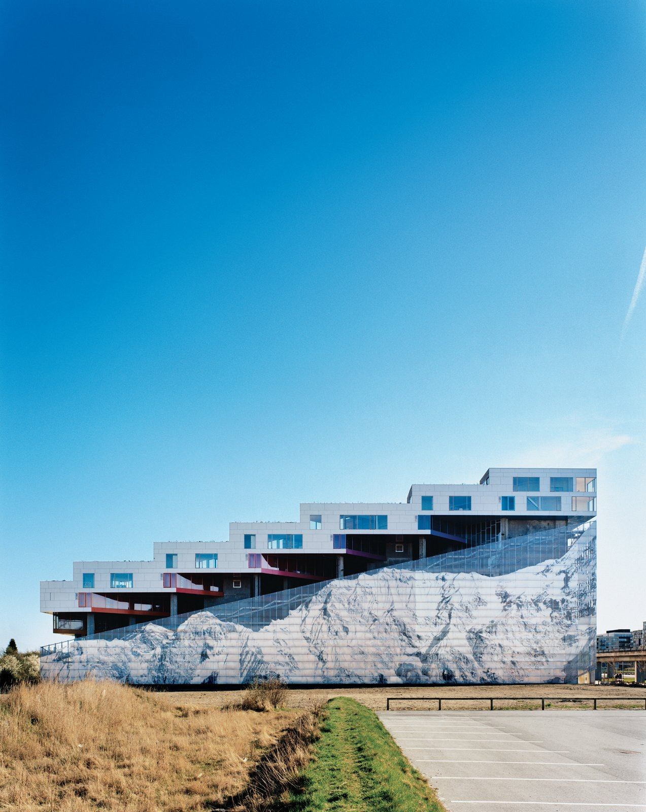 Completed in 2008, the Mountain Dwellings is the second of BIG's three projects in Ørestad, a new neighborhood in Copenhagen where development is attracting many new inhabitants. The result does looks like a mountain—hence the building's name and the inspiration for the mural of Mount Everest that adorns the 82-foot-high facade.  Modern Danish Homes We Love by Aileen Kwun from Mountain Dwellings Urban Development in Copenhagen