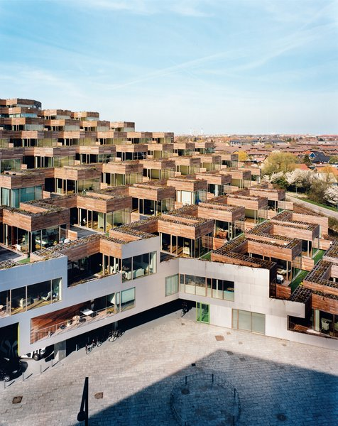 "Every apartment has a terrace measuring around 1,000 square feet, with both private and semipublic spaces. ""The cool thing about a garden is it's yours,"" says architect Bjarke Ingels. ""If you're on the wooden part, you can suntan in your bikini bottom or go without pants."" If, however, you walk out onto the artificial turf, you can see what's going on with your neighbors (and they can see you)."
