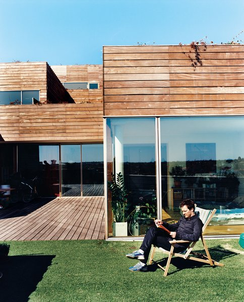 Airy, open, light-filled apartments with walls of glass look out onto 970-square-foot terraces edged in artificial turf. Unlike the too-public, near-exhibitionist qualities of the experimental VM housing next door, Mountain Dwellings all have private terraces and suburbanesque garden spaces.