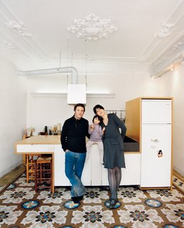 """Renovating Old and New in Barcelona - Photo 1 of 6 - """"We really love to cook and much of our home life revolves around our kitchen. When we have friends over it's great to buzz around here; it's almost like a cooking show. We're a very equal couple. We wanted the kitchen island to be a single form that we could both use. We can both cook and we can both wash the dishes. The whole thing is really easy to clean as it's just one main surface that you can wipe down. So the preparation surfaces, the hob [cooktop], and the sink are accessible from both sides. It's a simple, fun, form-follows-function principle: Store, wash, prepare, cook, eat."""""""