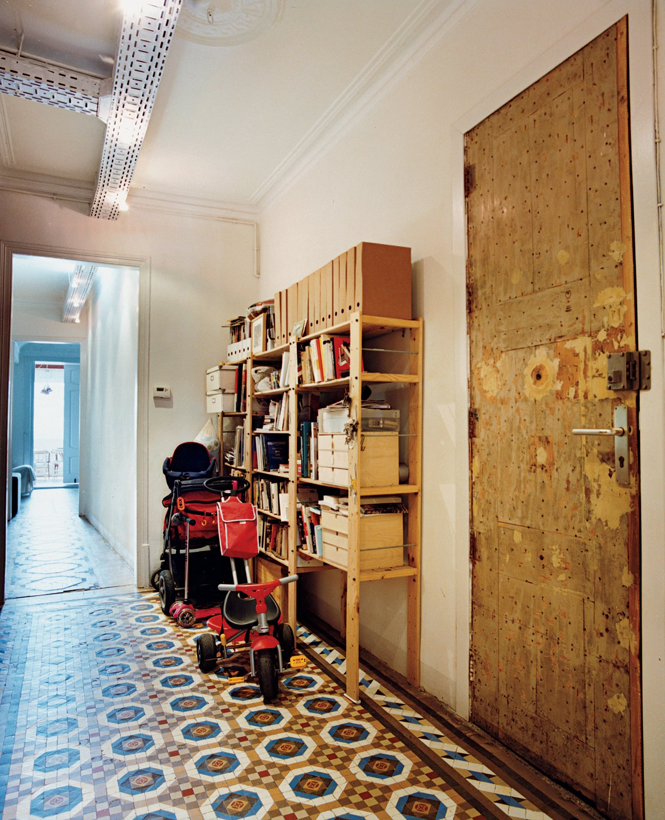 The front door hallway flooring features original turn-of-the-century floor tiles in this renovated first-floor apartment in Barcelona, Spain.  Photo 5 of 6 in Renovating Old and New in Barcelona