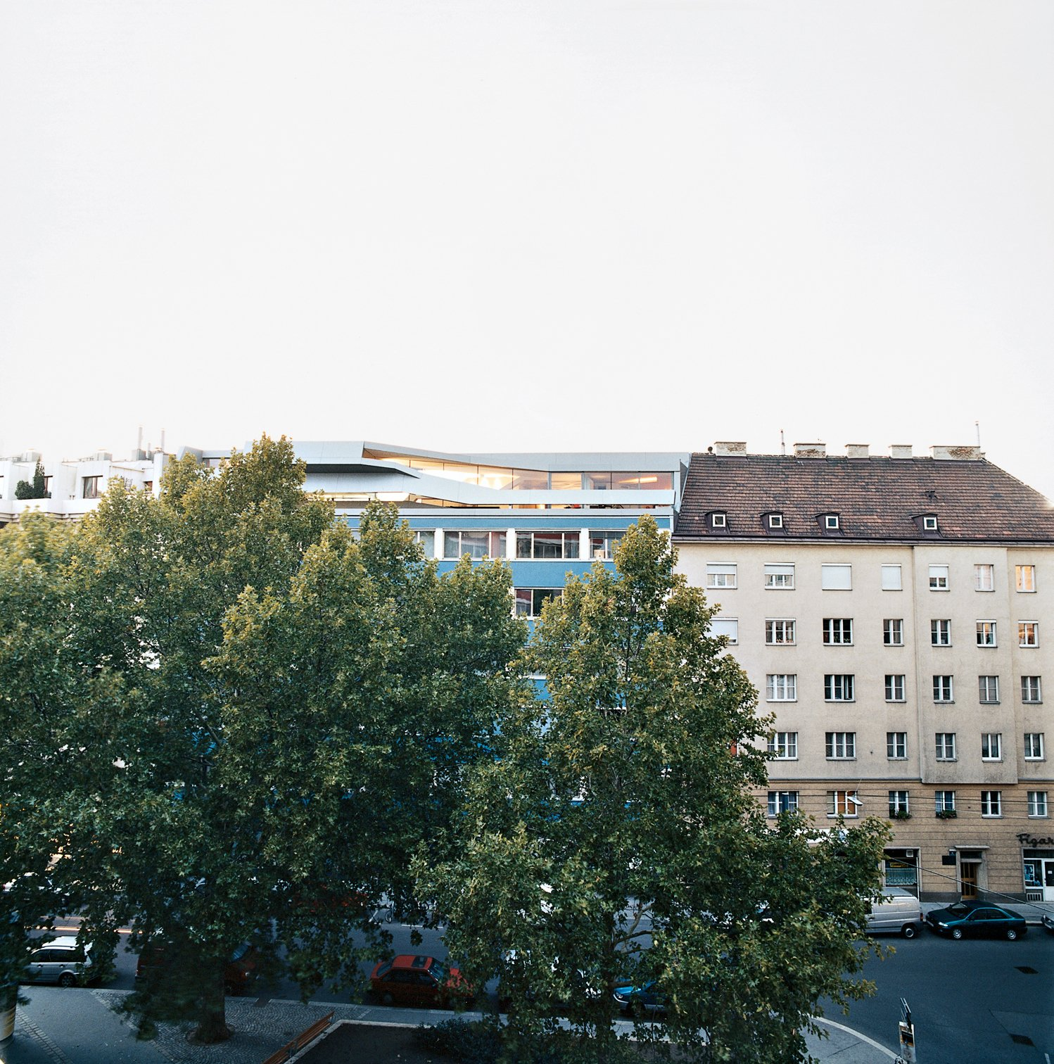 The penthouse is boldly inserted within the traditional rooftops in Vienna's Wieden district.  Photo 2 of 16 in The Penthouse Has Landed