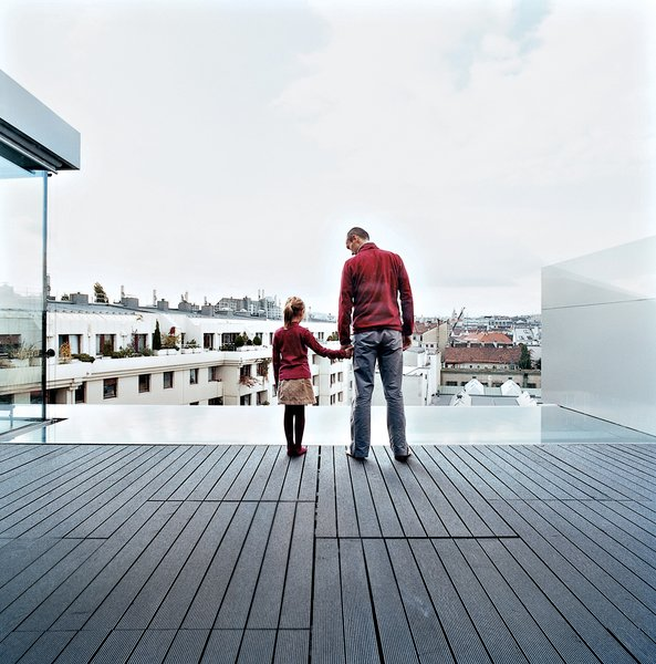 Roman and Nora stand on the terrace, and look out over the reflecting pool and beyond.  Photo 13 of 16 in The Penthouse Has Landed