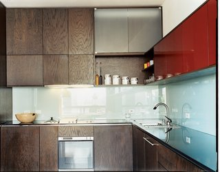 Making Sense of the City - Photo 5 of 11 - MS-31 designed and built all the kitchen cabinetry, as well as the dining table, in collaboration with Archkinetics. The frosted-glass backsplash offers easy cleaning.