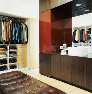 10 Modern Walk-In Closets - Photo 3 of 10 - Even in a tiny space, Sebastian Mariscal was able to include a roomy walk-in closet. It creates order in a space that has a high potential for disaster.