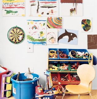 """Making Sense of the City - Photo 9 of 11 - Six-year-old Mateo's bedroom, which he calls his """"office,"""" provides an interesting contrast to his parents' orderly space. His talents are evident in his paintings, including """"Dalmation"""" (a white sheet of paper with a single black dot in the center)."""