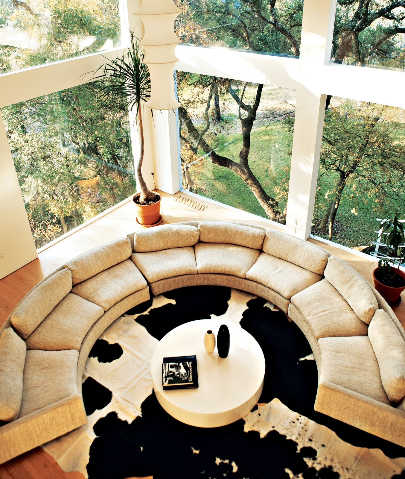 The curvy, off-white sofa, which forms a perfect conversation pit, was purchased on Ebay (and cost as much as it did to buy). 20 Modern Living Rooms - Photo 2 of 20