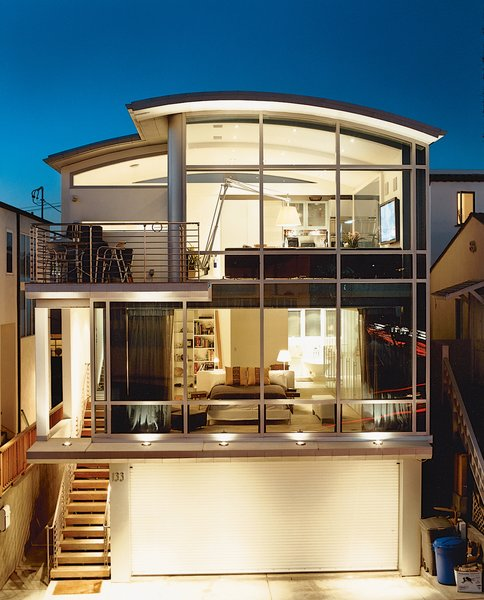 """""""It didn't bother me to do a house with a lot of things half the size of what people think is normal,"""" John Picard says of his half-lot home in Manhattan Beach. The home's steel frame offers a maximum expanse of glass. Because of the small footprint, Picard wanted every inch of the living space to be usable—which is made possible by the steel frame and a service core that runs the entire height of the building."""