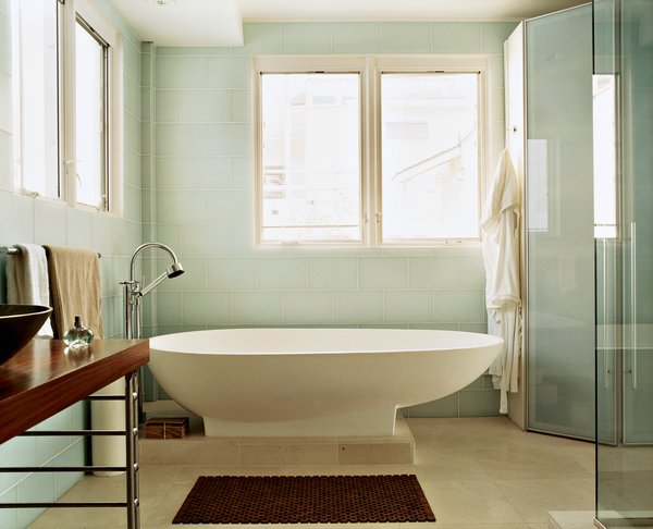 """Where the System 20 is the showpiece in the kitchen, from the master bedroom it's impossible not to notice the egg-shaped Agape tub in the doorless bathroom. Picard glibly remarks, """"When you're spending $6,000 on a tub and $2,000 on a faucet fixture, you've got to make sure what you're buying is something that stands out."""""""