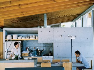 "Sold in some of Mexico's larger cities (Mexico City and Guadalajara), as well as in New York and Paris, Bernardo Gomez-Pimienta's design line, BGP, is perfectly sampled at the house in Valle de Bravo. Because the kitchen, dining area, and living room are a single space where Gomez-Pimienta kept materials minimal, the individual forms of the objects stand out. The Casa Ia tableware is that of the Habita Hotel; Java chairs surround the cantilevered concrete dining table; Attu armchairs welcome peaceful moments in the living room. Even the outdoor furniture is meticulously designed: ""The easy chairs have a somewhat industrial structure due to the stainless steel, but the knitted plastic gives them a soft and gentle gesture,"" he says."