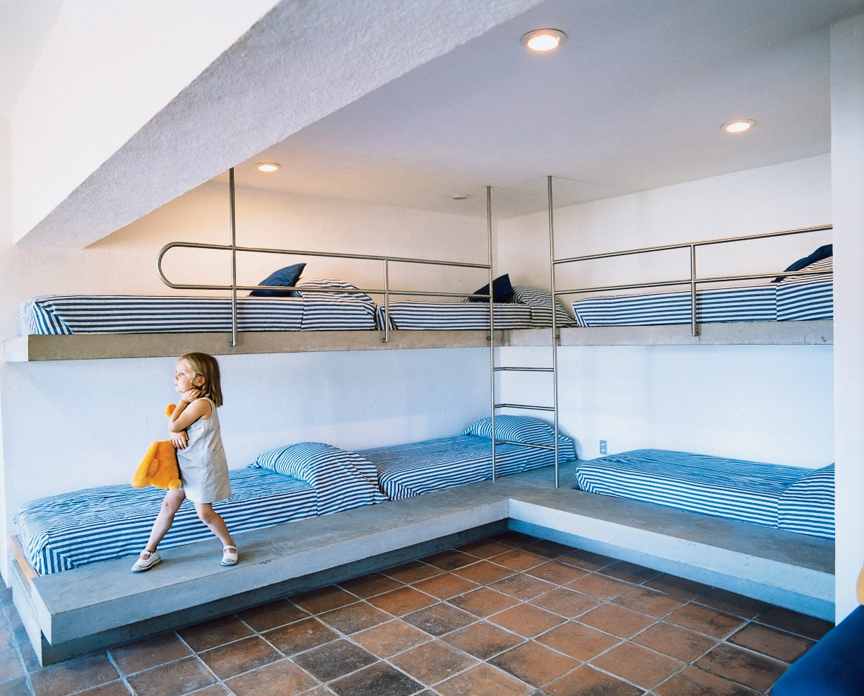 The rounded steel guardrails on the kids' bunk beds are meant to inspire fantasies of nautical adventures.  Photo 9 of 10 in Reflections on a Lake