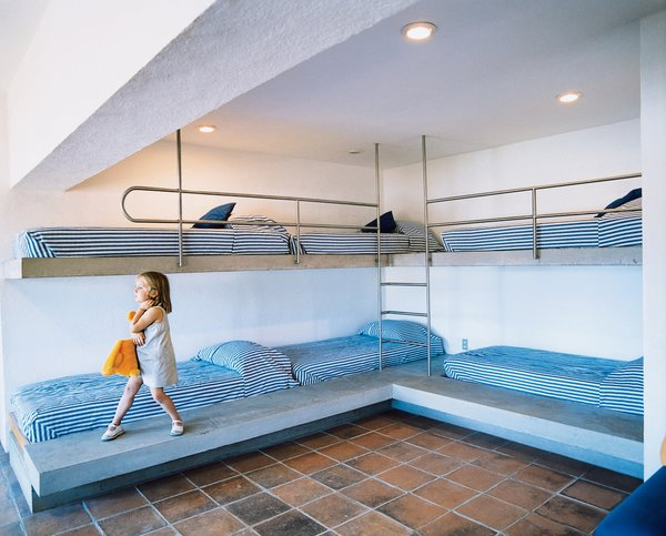 The rounded steel guardrails on the kids' bunk beds are meant to inspire fantasies of nautical adventures.