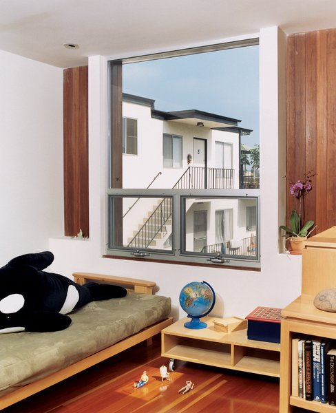 The girls' room features wood furniture designed by Bornstein.