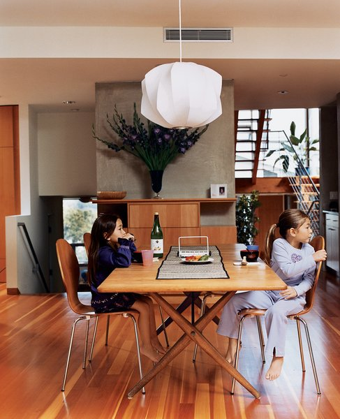 Kalia and Olivia in the dining room (the Danish dining table was acquired by Jesse's parents in the mid-'70s, the dining chairs are by Arne Jacobsen, and the light fixture is by George Nelson).