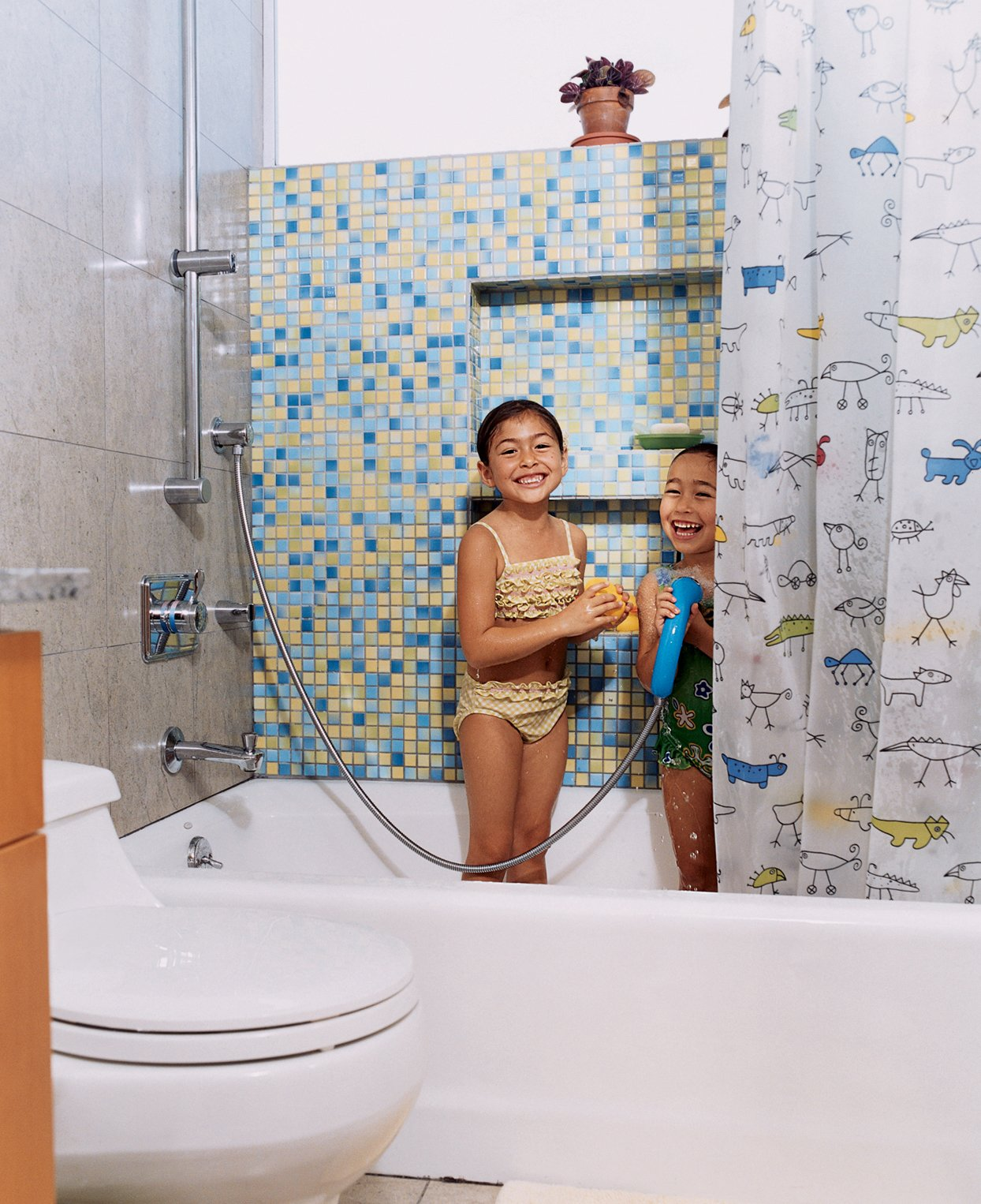 The sisters in their colorful bathroom with Kohler fixtures.  Photo 10 of 13 in Two Houses Are Better Than One