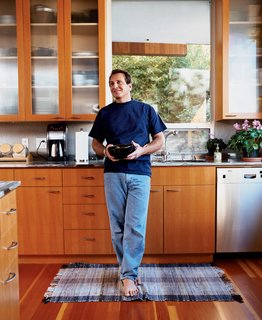 Two Houses Are Better Than One - Photo 11 of 13 - The architect at home in his kitchen with cabinetry that he also designed.