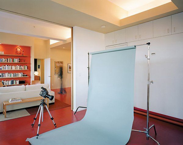 During the day, Dayton's guest bedroom easily doubles as his photography studio.