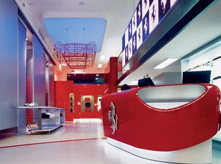 Like the aesthetics of Bolidism, a movement Iosa Ghini founded in 1985, fluid curves characterize many of his designs. Seen here is the interior of the Ferrari store in Rome, which he designed in 2004.