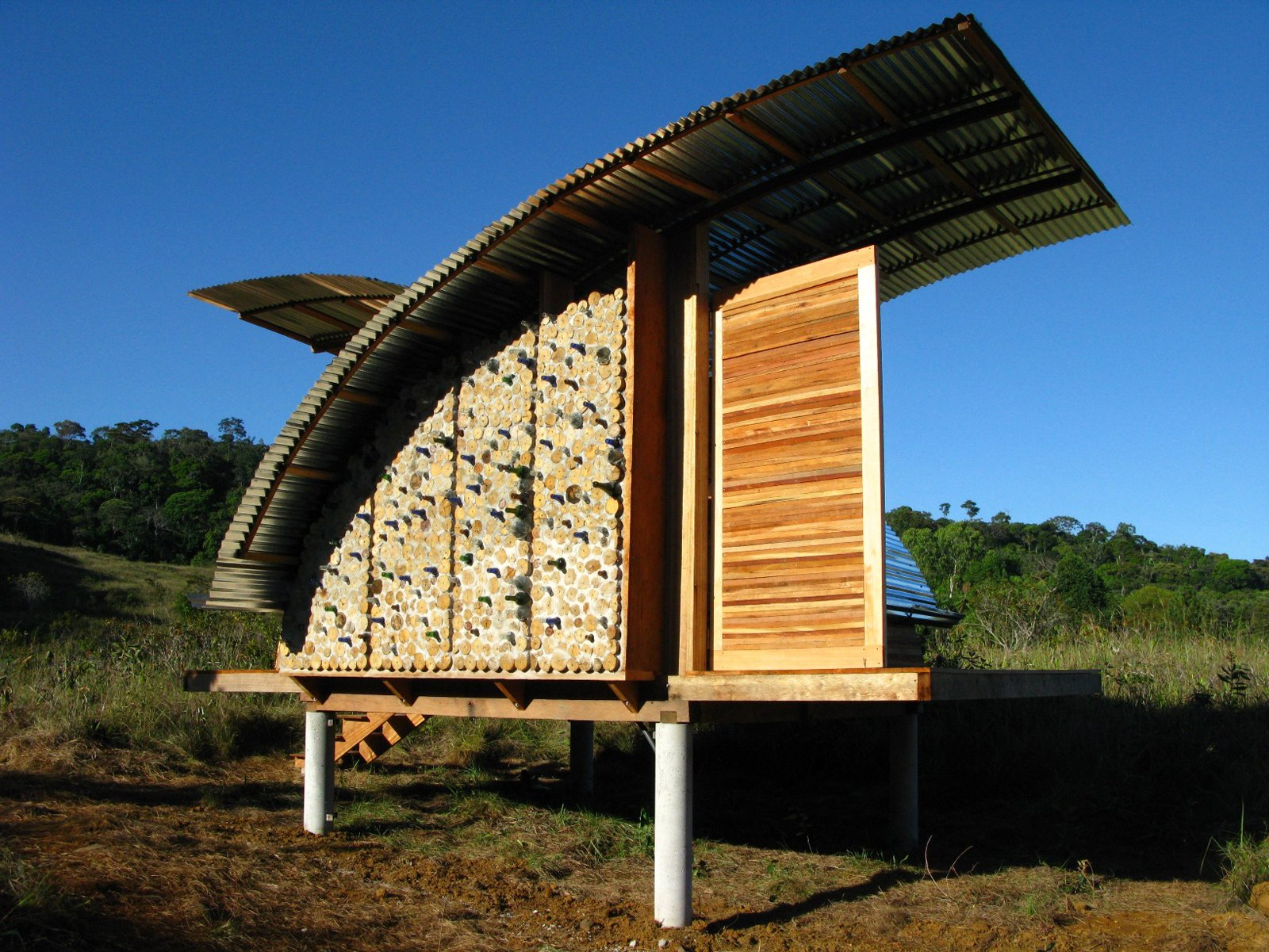 A sideview of the cabana shows off the most artistic facet of the design, where recycled bottles are embedded in the wall.  Photo 9 of 13 in Venezuela's Eco Cabanas