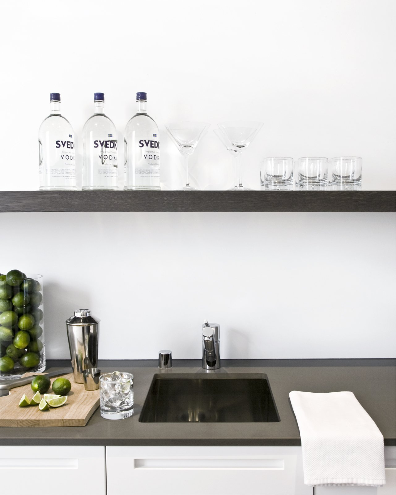 The wet bar at the end of the kitchen is equipped with a spout for filtered water, ice maker, wine fridge, and over-sink shelving--and is the happy-hour hotspot.Photo by   Ben Mayorga Photography  Photo 4 of 6 in 6 Home Wet Bars That Will Inspire You to Up Your Entertaining Game from Pacific Heights Remodel