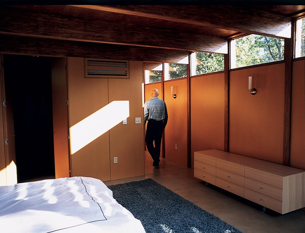 The house's interior walls are medium-density fiberboard, the sort of material that more typically is covered with drywall. Instead, the fiberboard was coated with a linseed oil to accent its natural, rich tan and finished with a catalyzed var-nish to make it water-resistant. The effect is an interior wall surface that complements the earth tones that dominate the house's decor and never needs to be painted.  Photo 8 of 8 in Four Walls and a Screw-Top