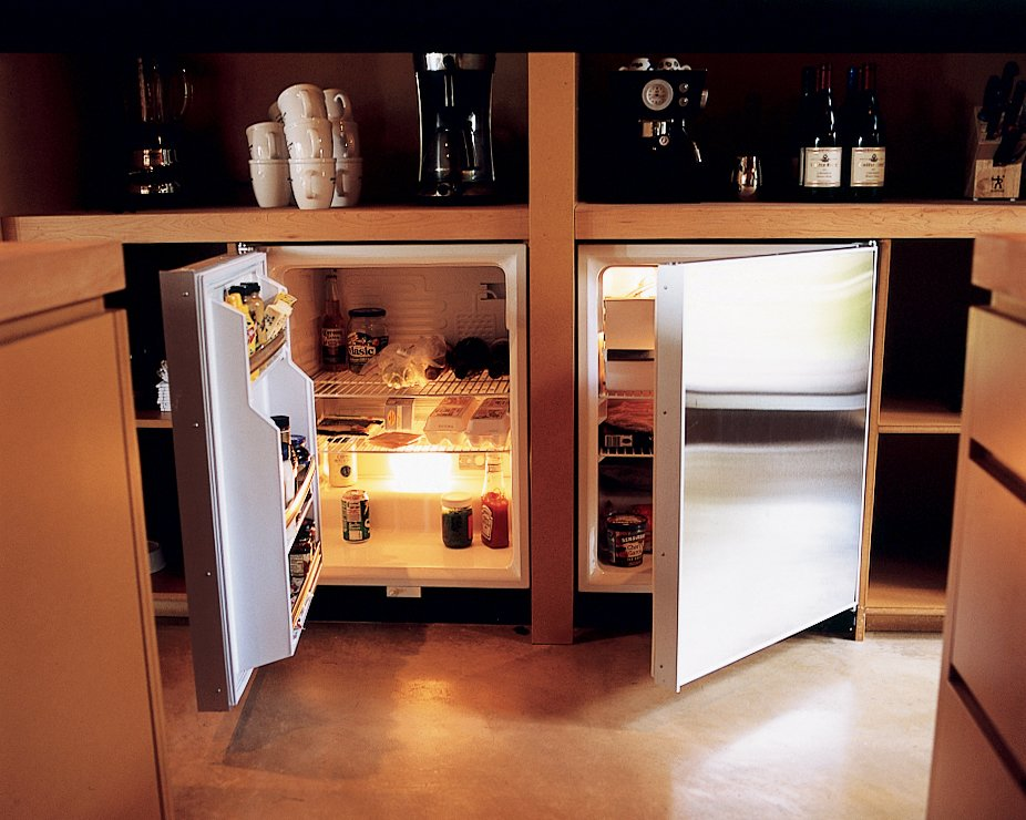 "To help keep the house free of clutter, the full-size refrigerator was hidden in a basement utility room. An unobtrusive three-foot-tall fridge and matching freezer—made by Sub-Zero—were tucked beneath a kitchen countertop. ""There are so many more options with refrigeration, and under-the-counter is really great,"" says Vetter. ""You free up space and don't have this big, clunky thing sitting there."" www.subzero.com"