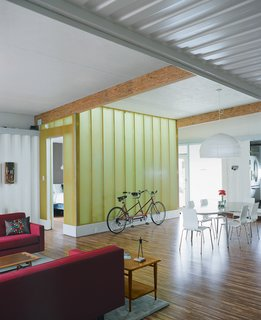Throughout the house, Robertson, Nichols, and Walker emphasized the beauty of the natural finishes and colors of the materials they chose. Robertson originally was going to paint the overhead beams but left them in their raw state to match the tiger bamboo that covers the floor. The light wall around the master bedroom, made from Enduro Systems fiberglass, is a light turquoise on the bedroom side, amber on the living room side, and glows green at night when the lights between the two layers are turned on.