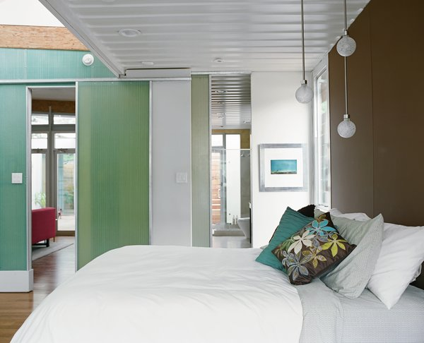 "Robertson wanted the family to feel the constraints of the containers, so he emphasized the bedroom ceilings.""You almost feel like a hobo on a train,"" Feldmann says, romanticizing about her view from bed."