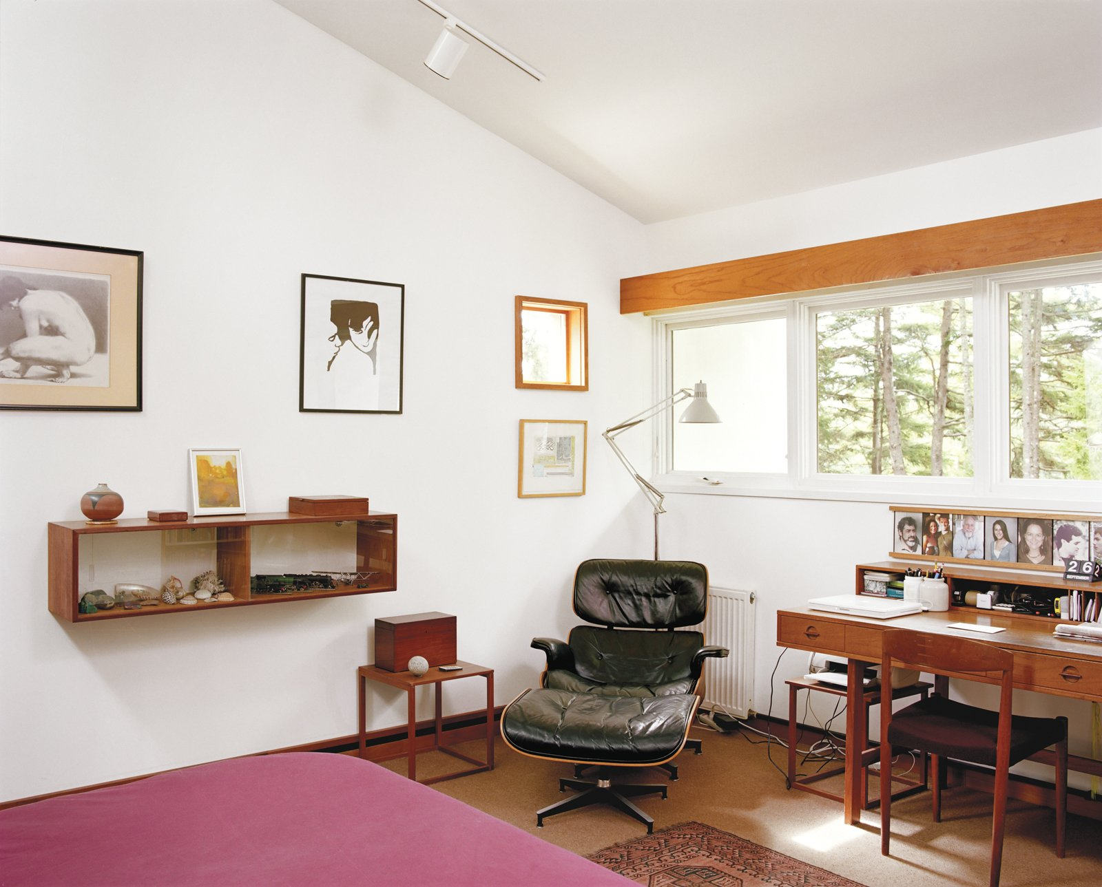 Classic mid-century furniture like the Eames lounge chair in Cohen's bedroom populate the home, a nod to his long life in architecture. Tagged: Bedroom, Chair, Bed, Rug Floor, and Track Lighting.  Photo 9 of 15 in The Right Track