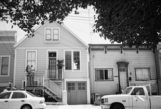 "The original home was built in 1901, five years before the 1906 earthquake and fires that destroyed much of the city. Since then, Bernal Heights has created its own planning code which requires new renovation to include two side-by-side, off-street parking spaces since the winding roads of the area make parking problematic. To do so, Willmer had to create a new, wider garage, but when she presented the design to the board for review, the historic technicians said that they wanted Willmer to keep the original garage door in order to maintain the historic fabric of the neighborhood. In the end, Willmer was able to keep the original door and gain permission to forgo adding the second parking space. ""The Ellers didn't want to park two cars inside the house,"" she says. ""It took up too much space.""<br><br>Photo by Ken Gutmaker"