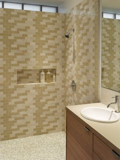 "The Ellers wanted their main bathroom to be lined with tiles but the expense was a limiting factor. To overcome this, Katie made frequent trips across the Golden Gate Bridge to Heath Ceramics in Sausalito to purchase seconds. ""She collected boxes and boxes over time, and then we arranged what she had in this pattern,"" Willmer says.<br><br>Photo by <br><br>Ken Gutmaker"