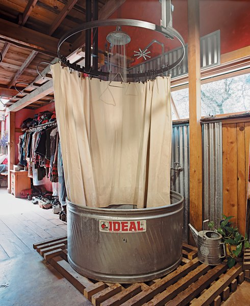 The showers are made from stock-watering tanks from the Ideal Stock Tank Co. and have waterproof canvas curtains. Less expensive than prefab shower-tub units, stock tanks are built of weatherproof galvanized steel and are sturdy enough for cows to drink from—–and, ergo, for you to bathe in.
