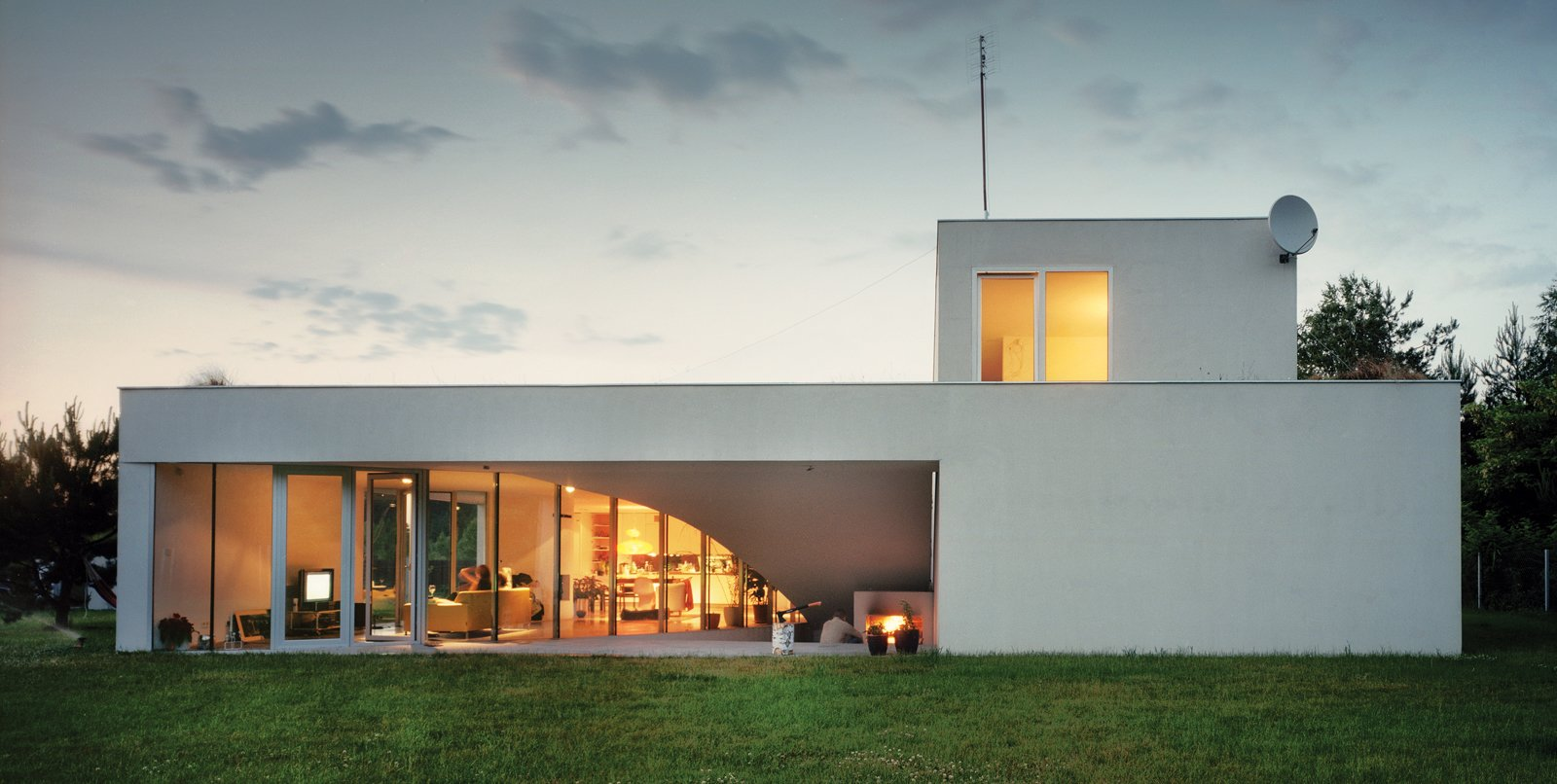 """Though the three-bedroom house is two stories, both floors offer """"front"""" lawns on which to hang out, all accessible through sliding glass doors.  Photo 3 of 3 in Modernist Rural Getaway in Poland"""