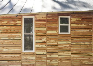 "By the Book - Photo 4 of 8 - The students also attempted to appease residents by making their home ""of the area."" They based the design on vernacular shotgun houses and bought the cedar siding as off-cuts from a local lumberyard, which totaled $120.<br><br>Photo by <br><br>Ty Cole"