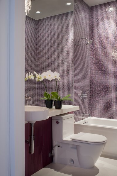 The main-level bathroom is finished quite similarly to that of the master suite: an Arcitec sink and Stark 2 toilet by Duravit, a crystal sconce by Eurofase, and tiles by Bisazza.<br><br>Photo by <br><br>Sharon Risedorph