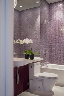 Noe Valley Renovation - Photo 13 of 17 - The main-level bathroom is finished quite similarly to that of the master suite: an Arcitec sink and Stark 2 toilet by Duravit, a crystal sconce by Eurofase, and tiles by Bisazza.<br><br>Photo by <br><br>Sharon Risedorph